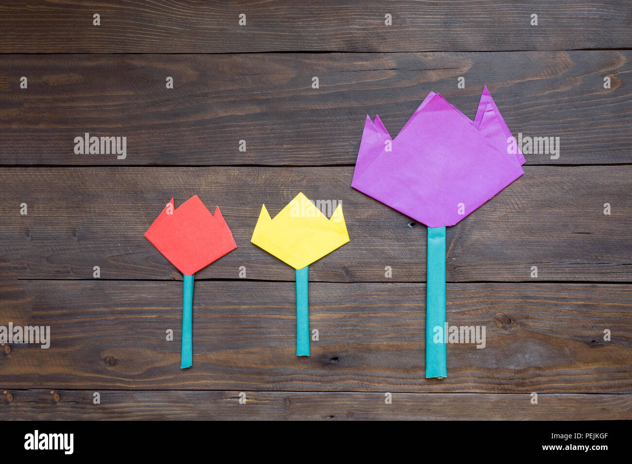 Childrens Crafts Origami Paper Flowers On A Dark Wooden Table