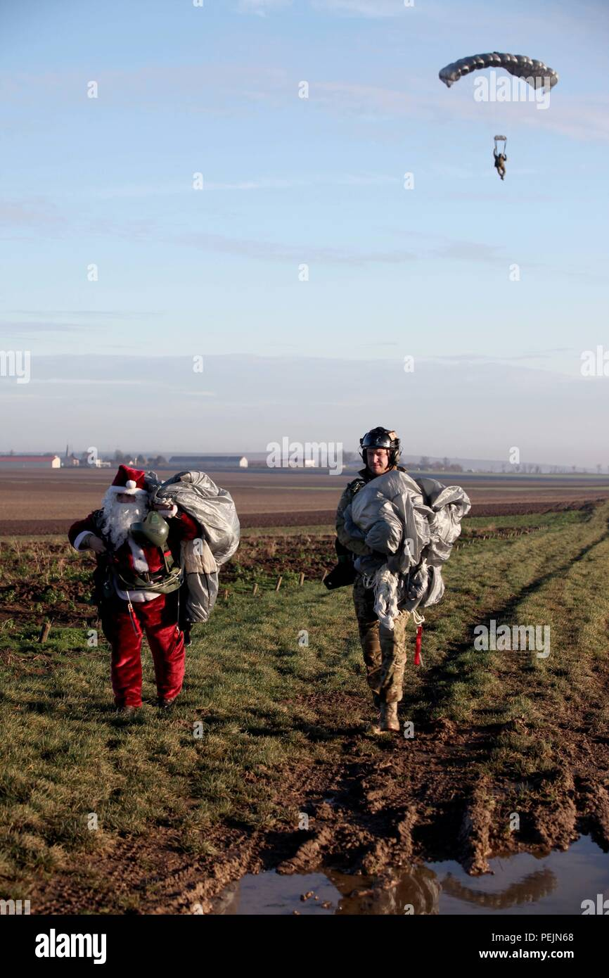 Santa descends onto Drop Zone ALZEY on Dec. 7, 2015, in support of Operation Toy Drop. He prepares to give the toys that were collected throughout the year to deserving children. (Spc. Joshua Lowery/Released) - Stock Image