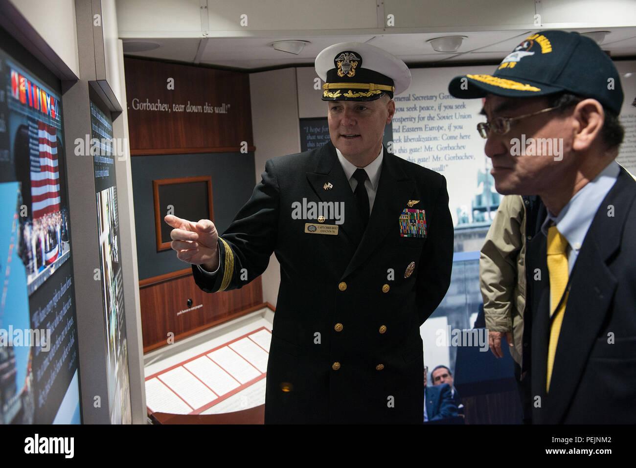 151209 N Wa993 119 Yokosuka Japan Dec 9 2015 The Commanding Taro Navy Officer Of Us Navys Only Forward Deployed Aircraft Carrier Uss Ronald Reagan Cvn 76 Capt Chris Bolt Left Gives Minister Kono
