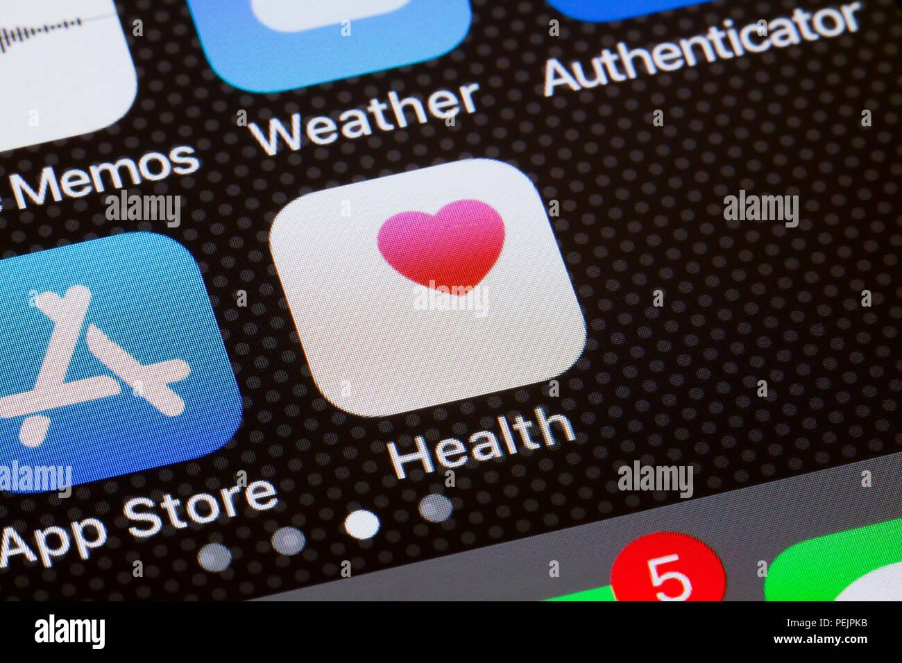 Health app icon on iPhone screen - USA - Stock Image