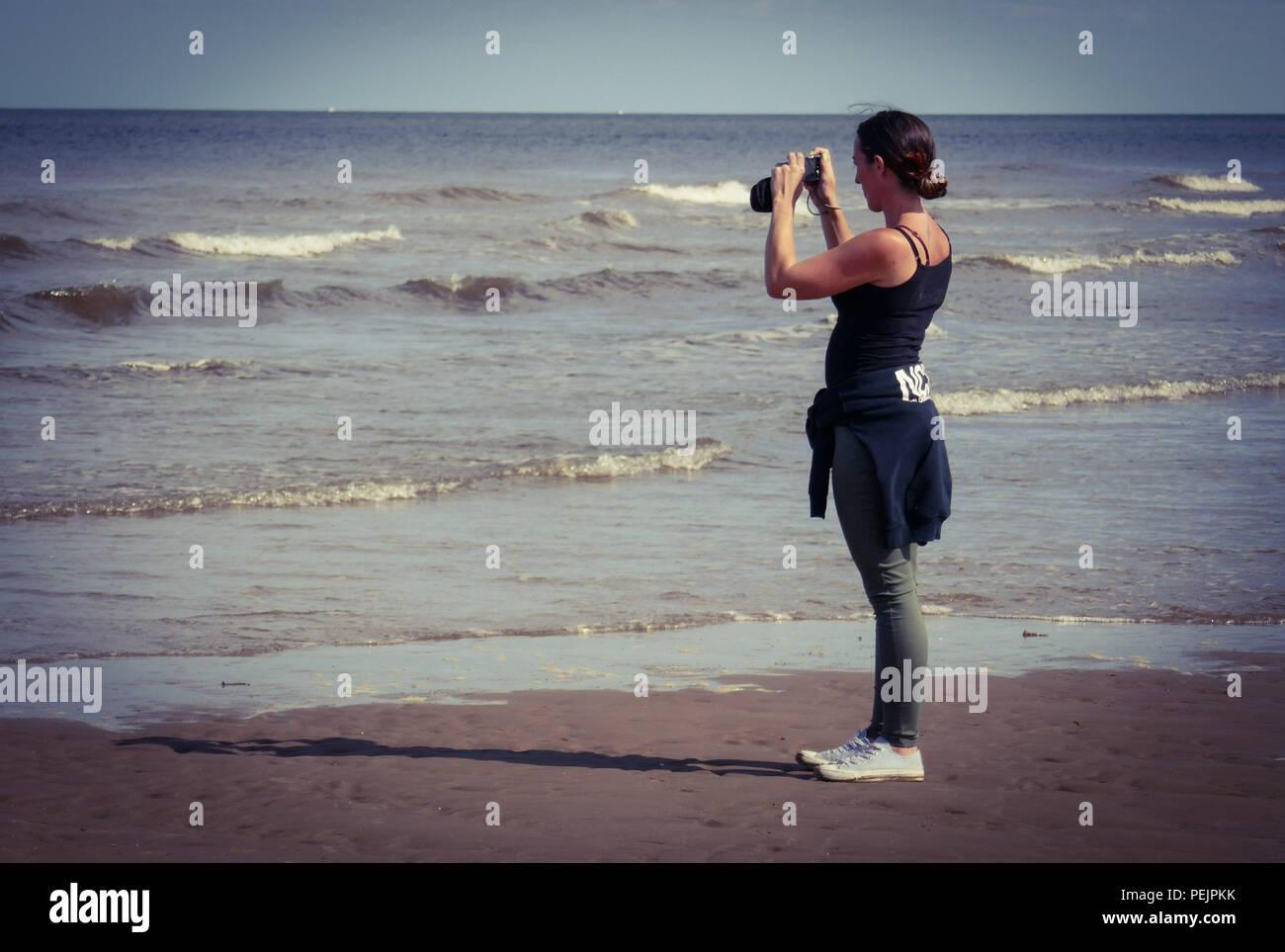 Girl on the beach - Stock Image