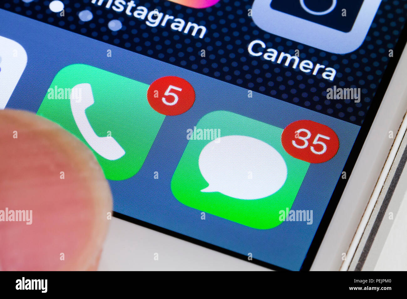 iPhone Phone and Messages icons showing missed calls notification badge (badges) - USA - Stock Image