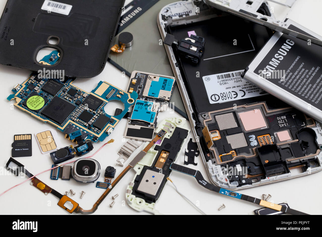 Disassembled Samsung Galaxy mobile phone, showing various internal components - USA - Stock Image