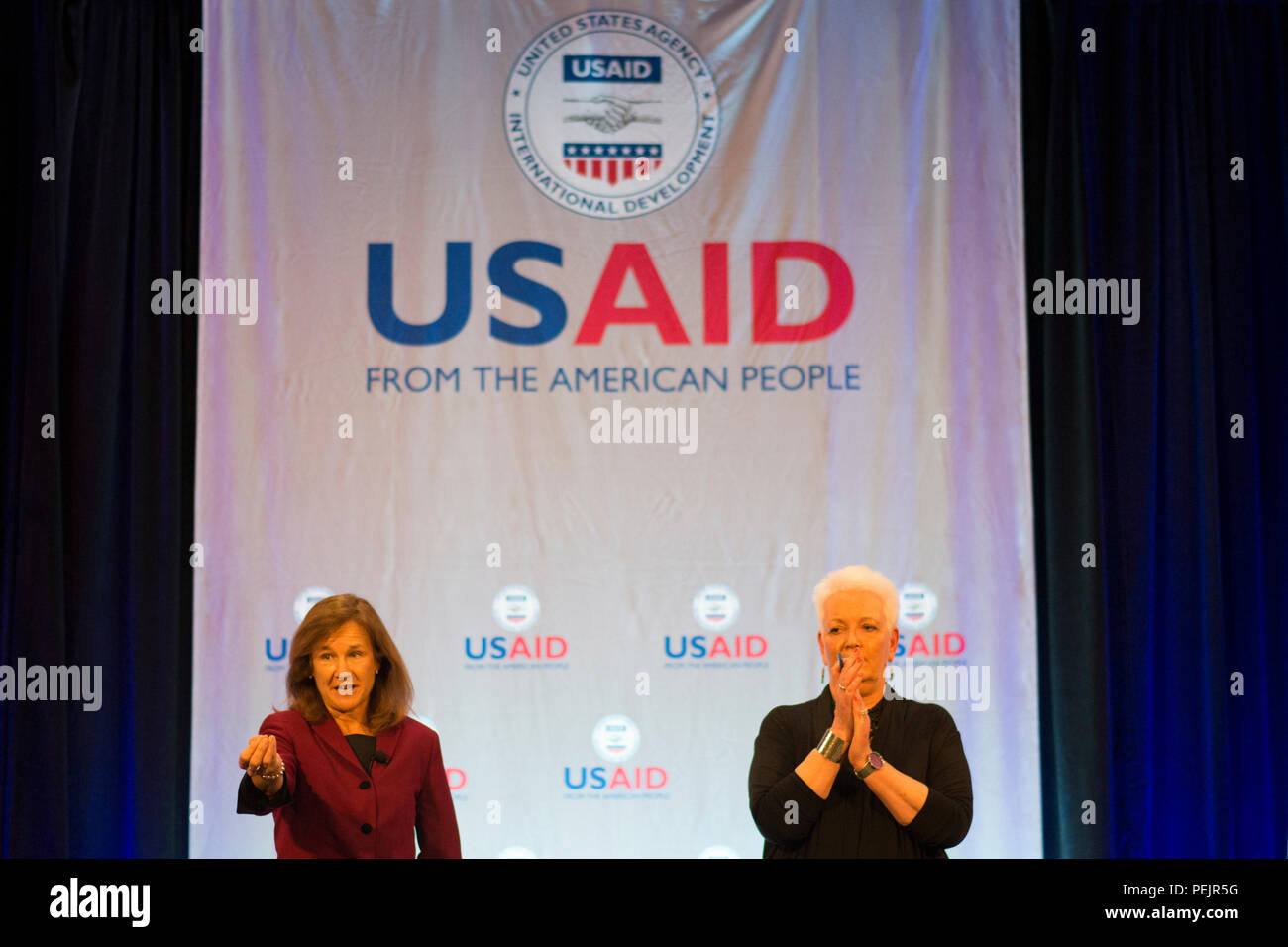 U.S. Agency for International Development's new administrator, Gayle Smith, and Senior Foreign Service Officer, Susan Reichle, take questions from USAID staff at a town hall meeting in Washington, Dec. 10, 2015. Smith is the 17th administrator for USAID. (Photo by Mark Burrell/USAID) - Stock Image