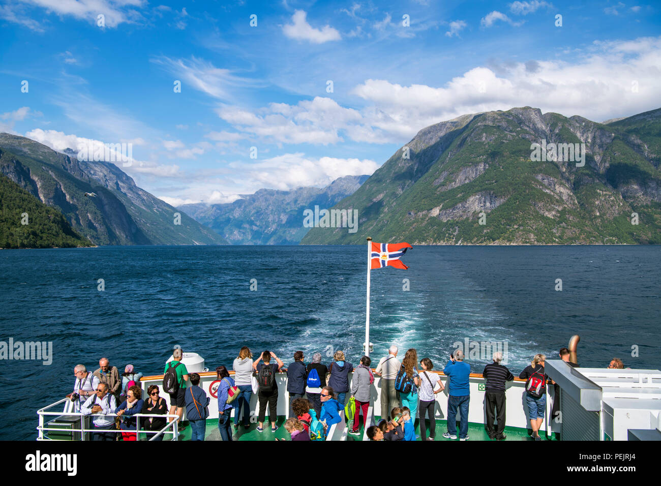 Geiranger, Norway. Tourists on the deck of the Geiranger to Hellesylt ferry, Geirangerfjord, Norway - Stock Image
