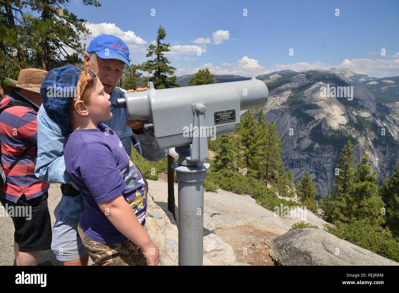 A tourist takes a closer look at Half Dome in the Yosemite National Park, California, USA - Stock Image