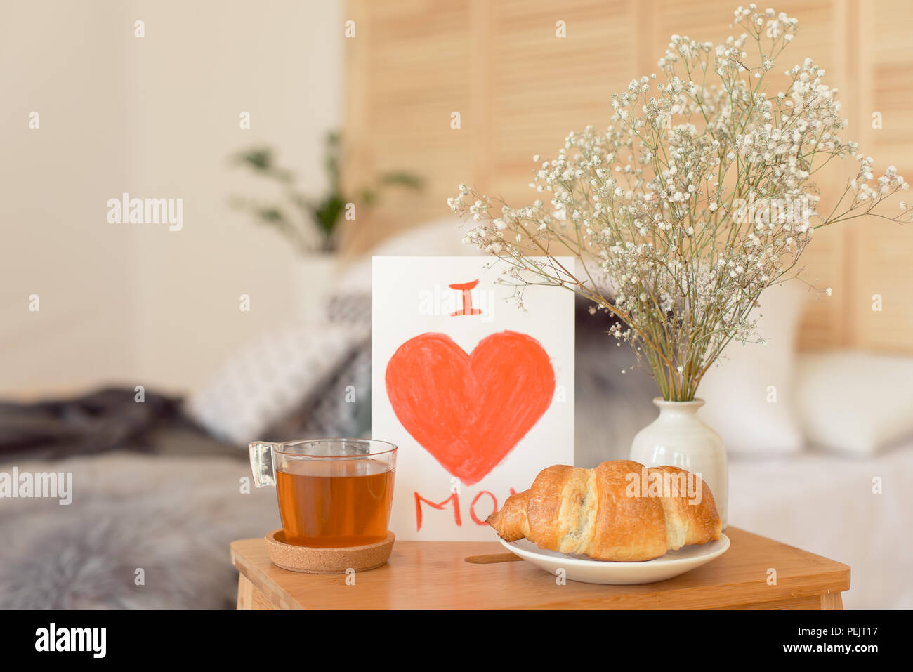 Mothers morning breakfast on wooden tray near bed with greeting mothers morning breakfast on wooden tray near bed with greeting card i love you mom mothers day concept m4hsunfo
