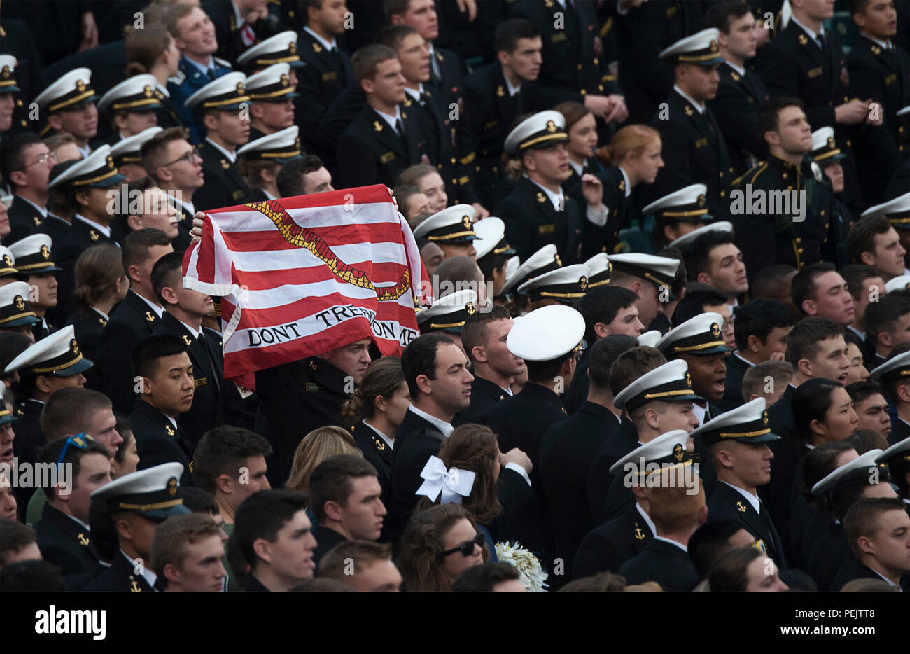 A Midshipman holds up the