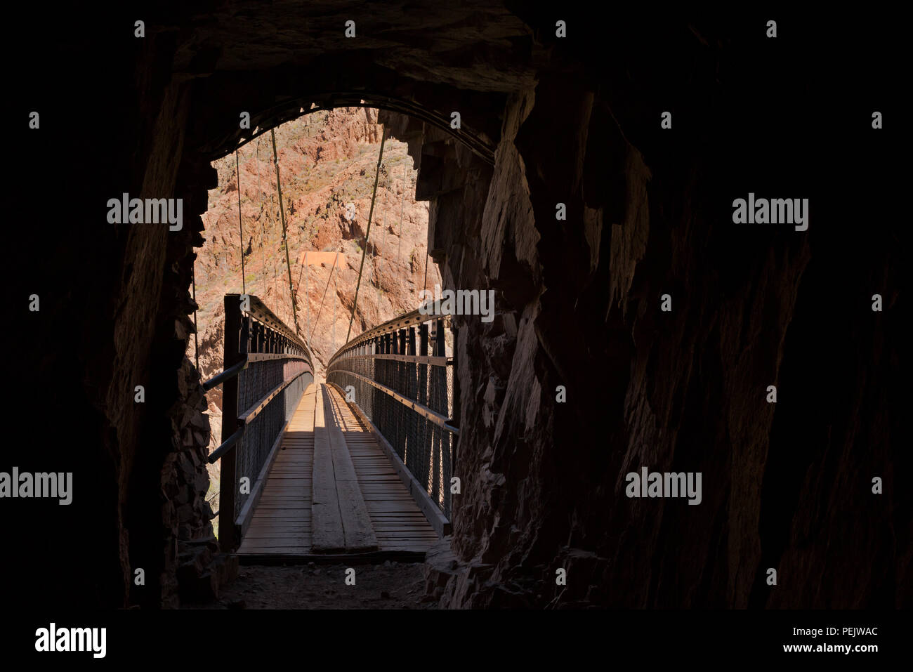 AZ00288-00...ARIZONA - Tunnel through a rock wall leading to the Black Bridge over the Colorado River on the South Kaibab Trail in Grand Canyon Nation - Stock Image