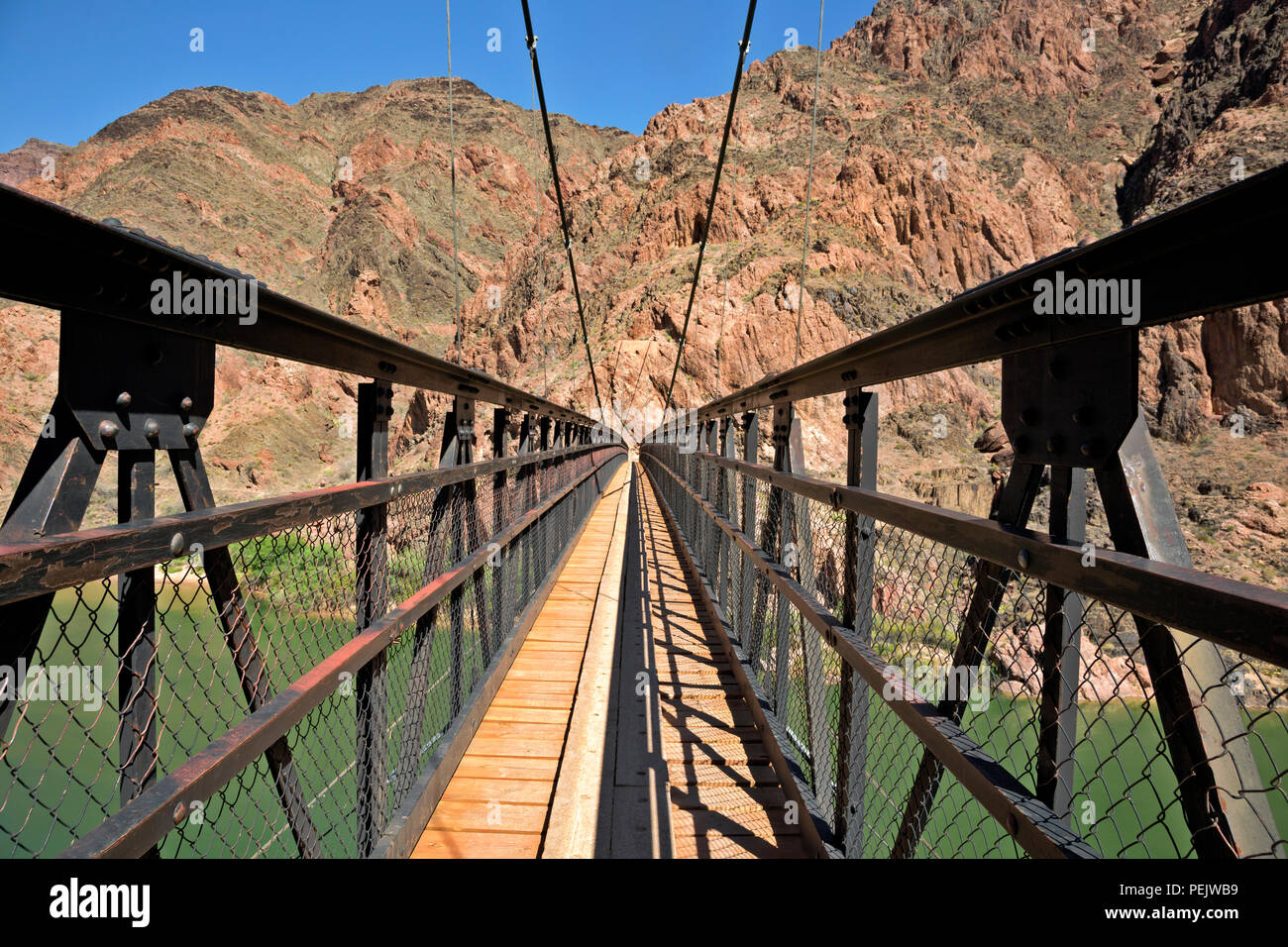 AZ00289-00...ARIZONA - The Black Bridge over the Colorado River on the South Kaibab Trail in Grand Canyon National Park. Stock Photo