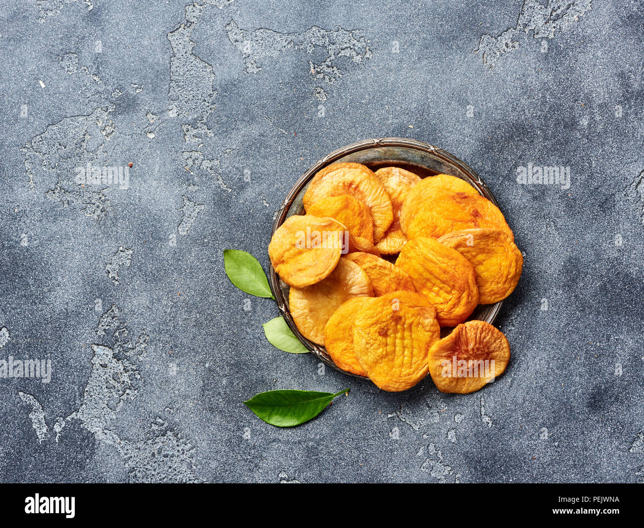 Dried apricots on gray background. Top view. - Stock Image