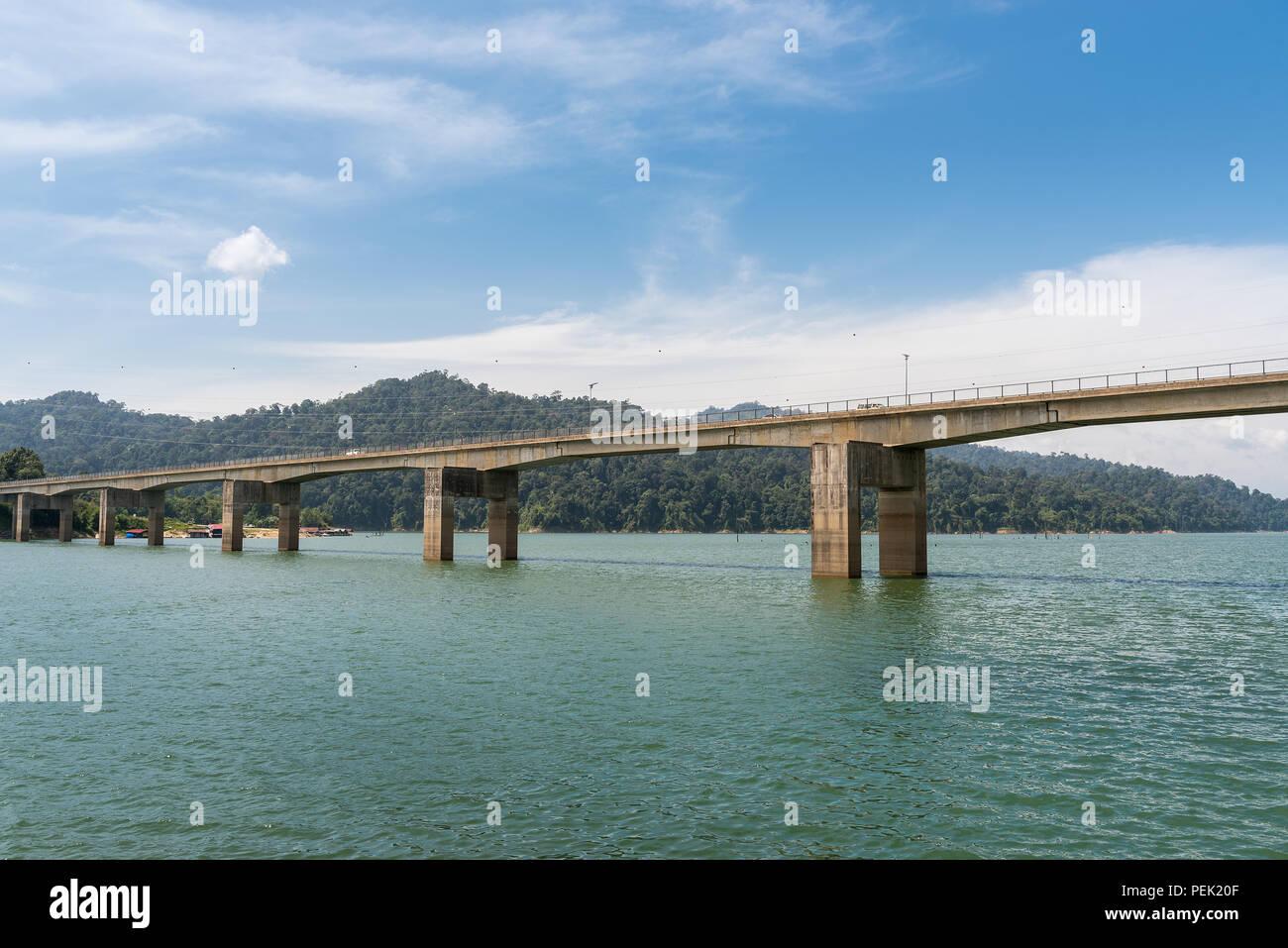 A concrete bridge at Lake Banding or Tasik Banding in Kelantan, Malaysia. - Stock Image