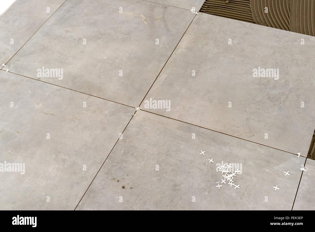 Ceramic Tiles Floor Tiles Installation In New Apartment Stock Photo