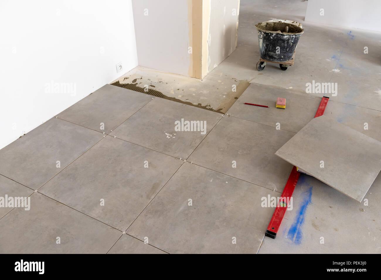 Floor tiles installation  Home improvement, renovation