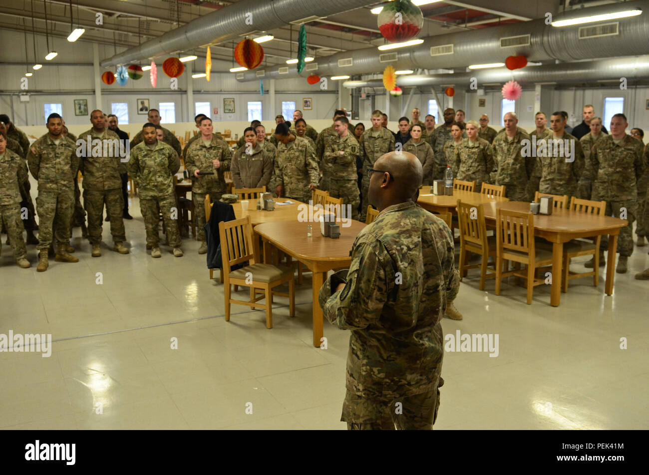 Newly promoted Sgt. Maj. Bryan Smith, the operations noncommissioned officer in charge of 149th Human Resource Texas Army National Guard, originally from Freeport, Texas, thanks his Soldiers and friends for their attendance and support during his promotion ceremony at Mihail Kogălniceanu Air Force Base, Romania, Dec. 10, 2015. (U.S. Army Photo by Staff Sgt. Steven M. Colvin/Released) - Stock Image