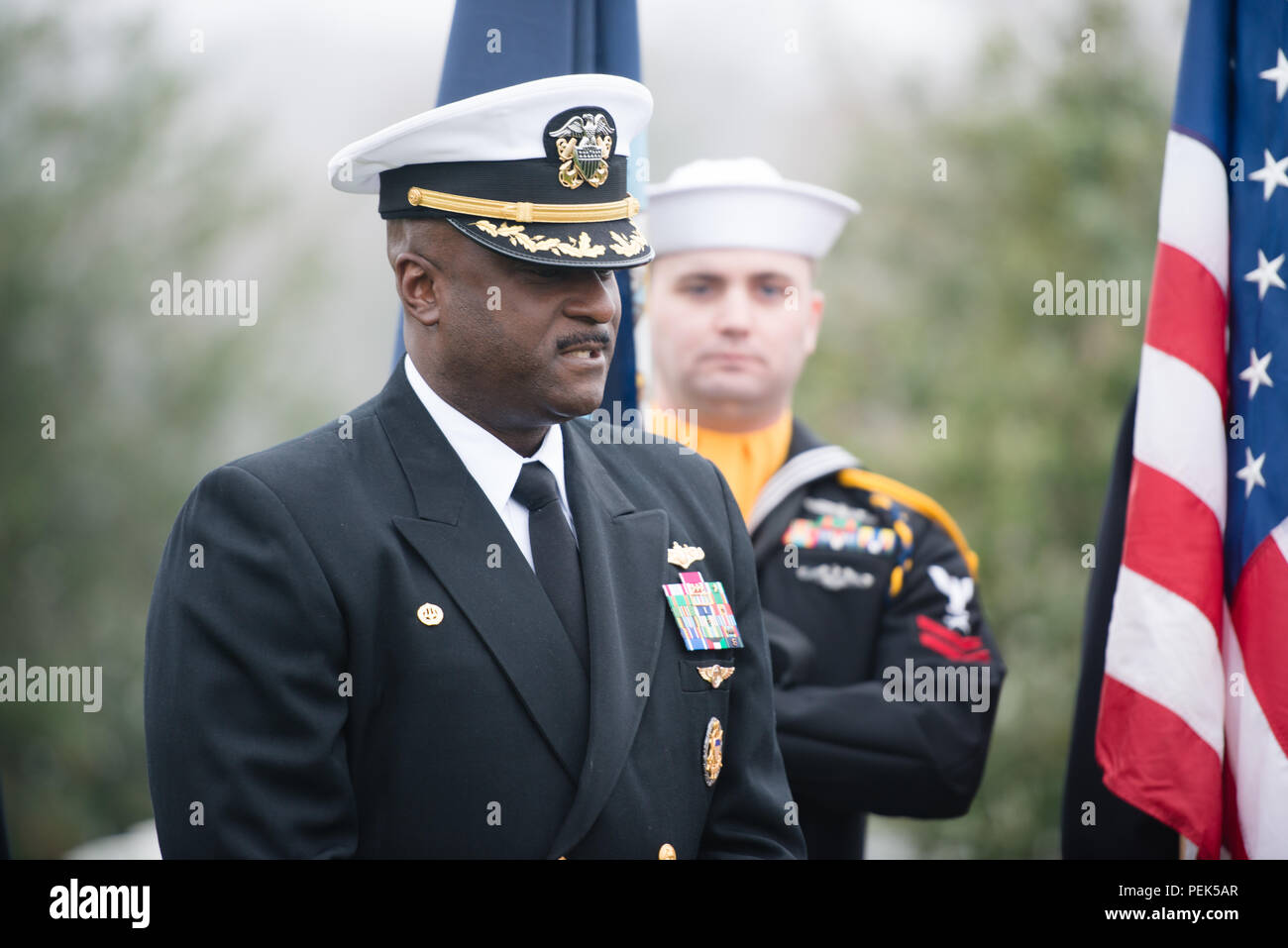 "Capt. Darryl Jackson, commanding officer, Hopper Information Services Center, gives remarks during a ceremony to honor U.S. Navy Rear Adm. Grace Hopper at Arlington National Cemetery, Dec. 9, 2015, in Arlington, Va. Hopper was a pioneering computer scientist and was nicknamed ""Amazing Grace."" (U.S. Army photo by Rachel Larue/Arlington National Cemetery/released) - Stock Image"