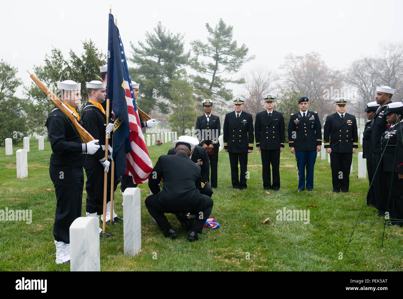 "Capt. Darryl Jackson, commanding officer, Hopper Information Services Center, and Cmdr. Joseph Fraser lay a wreath at the gravesite of U.S. Navy Rear Adm. Grace Hopper during a ceremony at Arlington National Cemetery, Dec. 9, 2015, in Arlington, Va. Hopper was a pioneering computer scientist and was nicknamed ""Amazing Grace."" (U.S. Army photo by Rachel Larue/Arlington National Cemetery/released) - Stock Image"