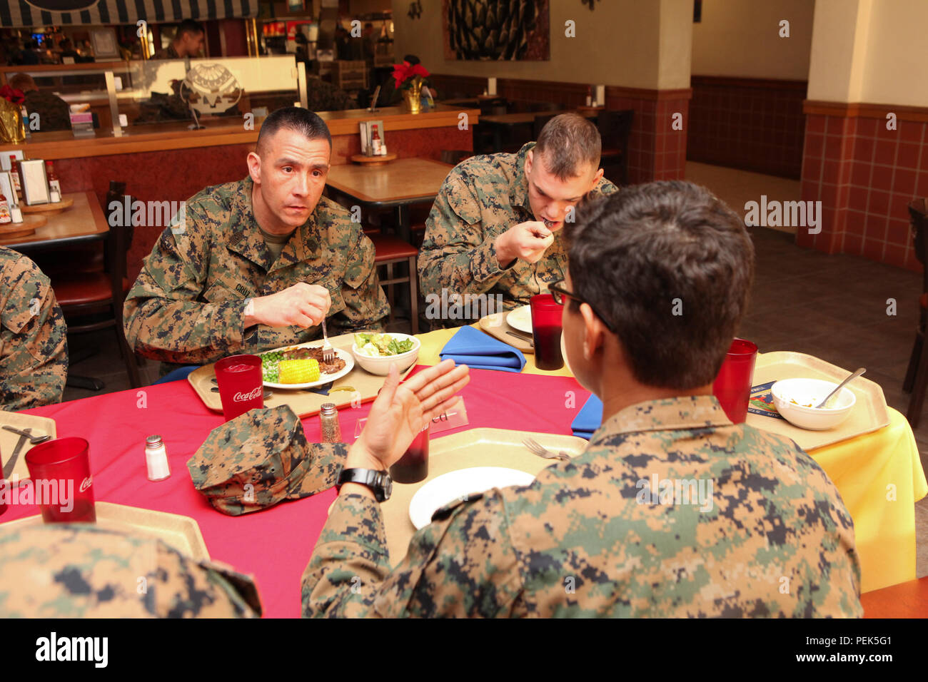 U.S. Marine Corps Installations Command (MCICOM), SgtMaj. Anthony Cruz has lunch with the Marines stationed aboard Marine Corps Air Station (MCAS) Yuma, Ariz., at Dec. 10, 2015. MajGen. Charles Hudson and SgtMaj. Cruz socializes and mentors the Marines of the current generation. (U.S. Marine Corps photo taken by LCpl. AaronJames B. Vinculado/Released) - Stock Image