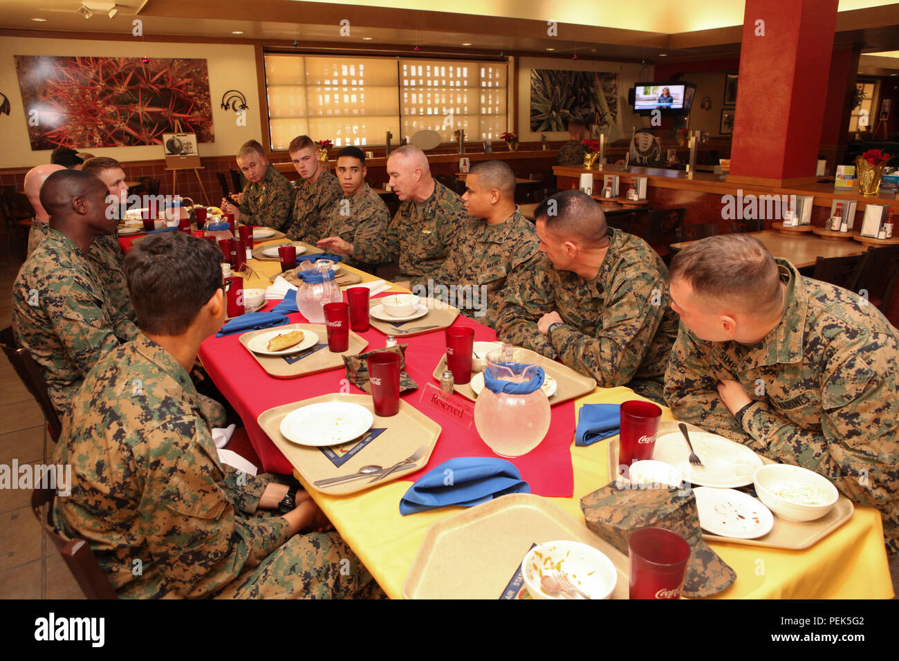 U.S. Marine Corps Installations Command (MCICOM), MajGen. Charles Hudson and SgtMaj. Anthony Cruz has lunch with the Marines stationed aboard Marine Corps Air Station (MCAS) Yuma, Ariz., at Dec. 10, 2015. MajGen. Hudson and SgtMaj. Cruz socializes and mentors the Marines of the current generation. (U.S. Marine Corps photo taken by LCpl. AaronJames B. Vinculado/Released) - Stock Image