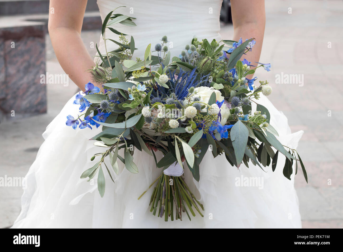 the Wedding bouquet of dried flowers, eucalyptus, peony, dahlias and ...