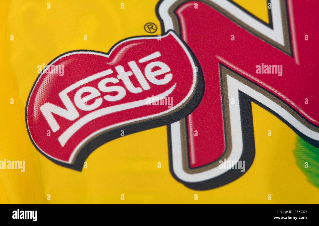 HUETTENBERG, GERMANY- JUNE 7, 2018: NESTLE Logo of Bar of NUTS Chocolate in Detail. - Stock Image