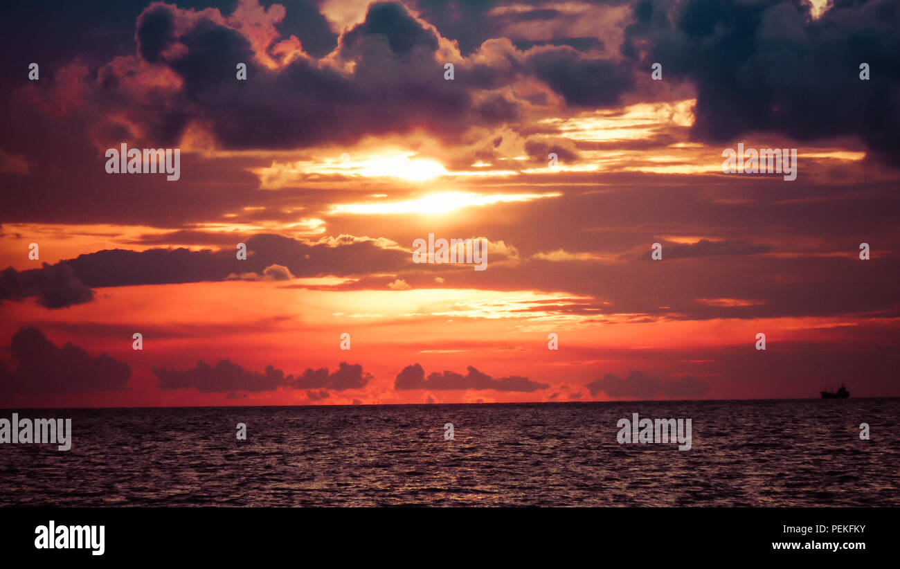 Landscape view of a sunset over the South China sea, in the island of Borneo in Malaysia - Stock Image