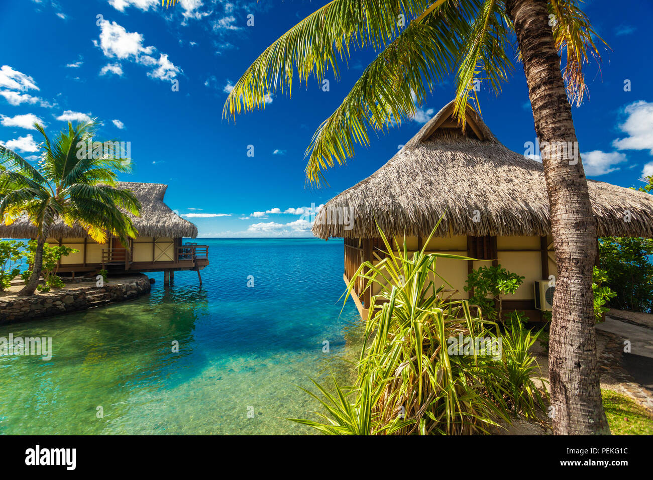 Over water bungalows and amazing green lagoon, Moorea, French Polynesia Stock Photo