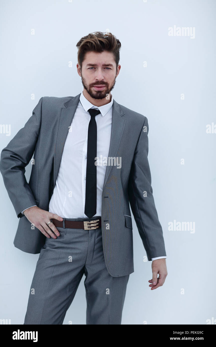 serious businessman with hands on hips, isolated background - Stock Photo