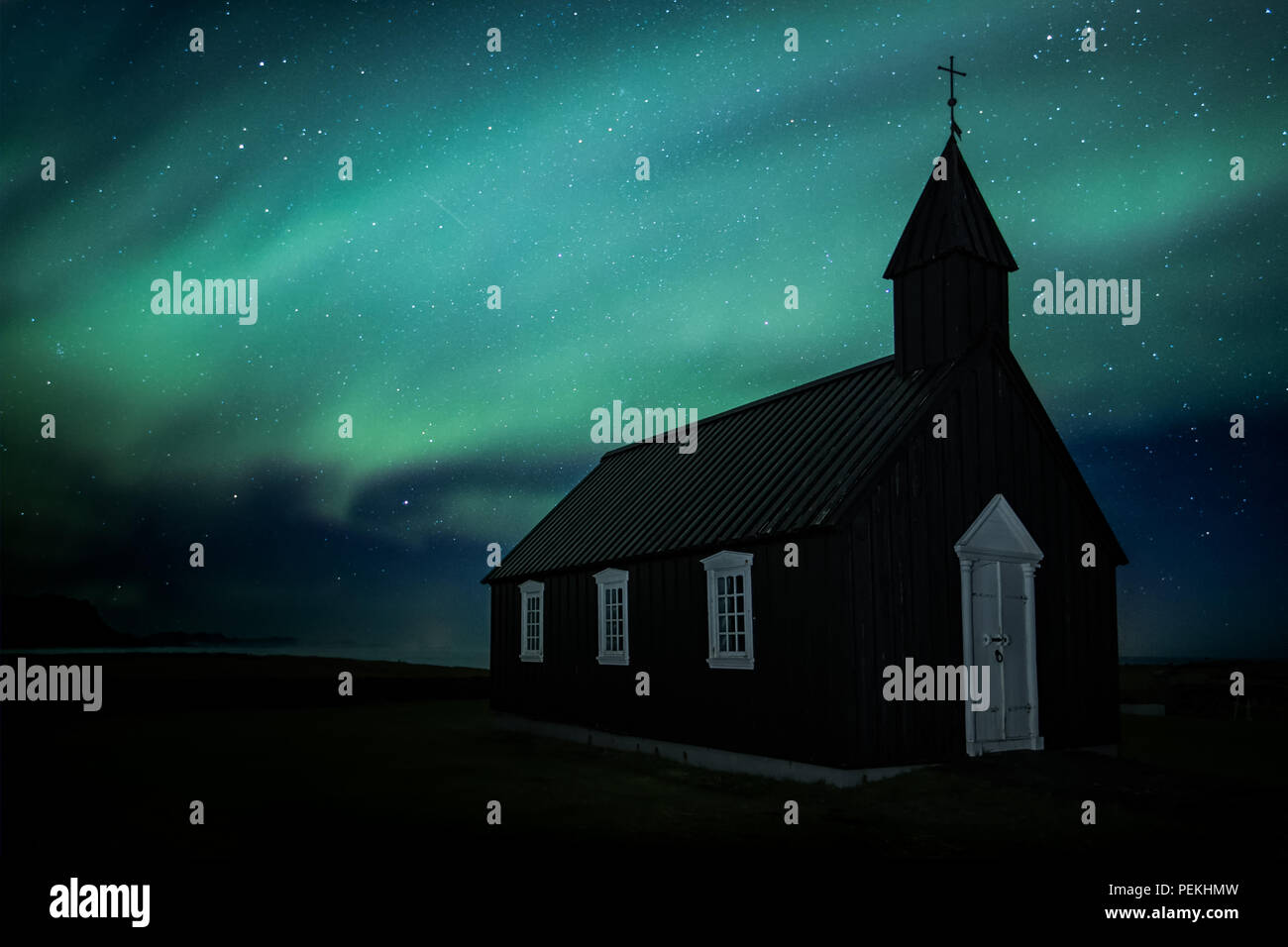 Budir Church Under the Aurora Borealis and Northern Lights On the Snaefellsnes Peninsula, Iceland - Stock Image