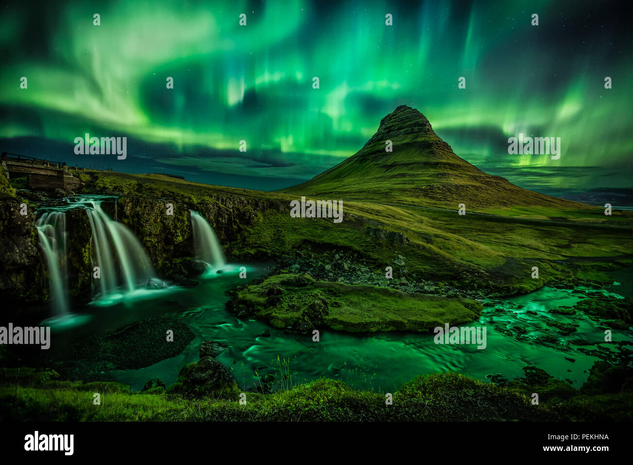 Aurora Borealis (Northern Lights) over Kirkjufell Mountain In Iceland - Stock Image