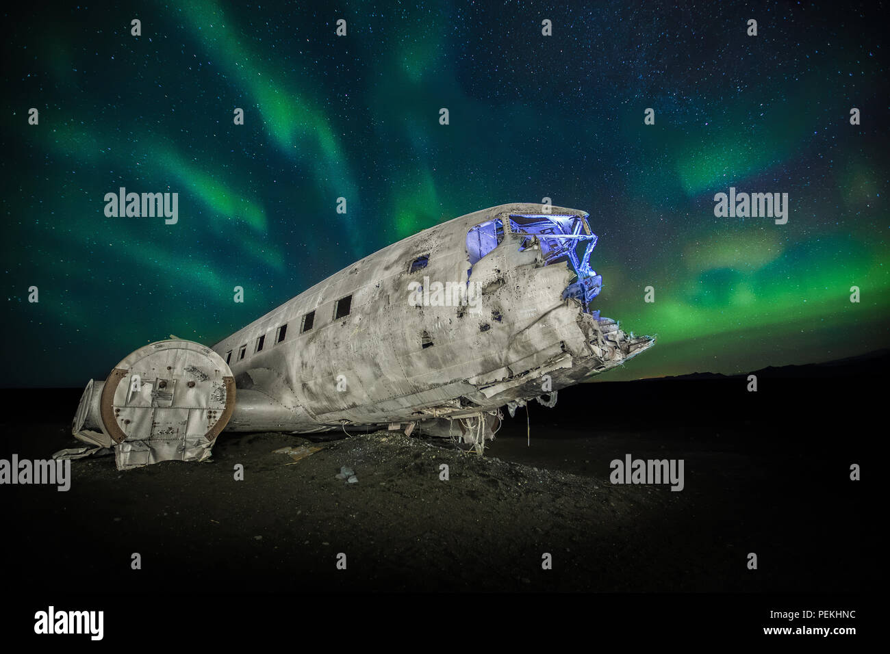 The crashed DC-3 Plane wreck with Northern Lights & Aurora Borealis at Solheimasandur, Iceland - Stock Image