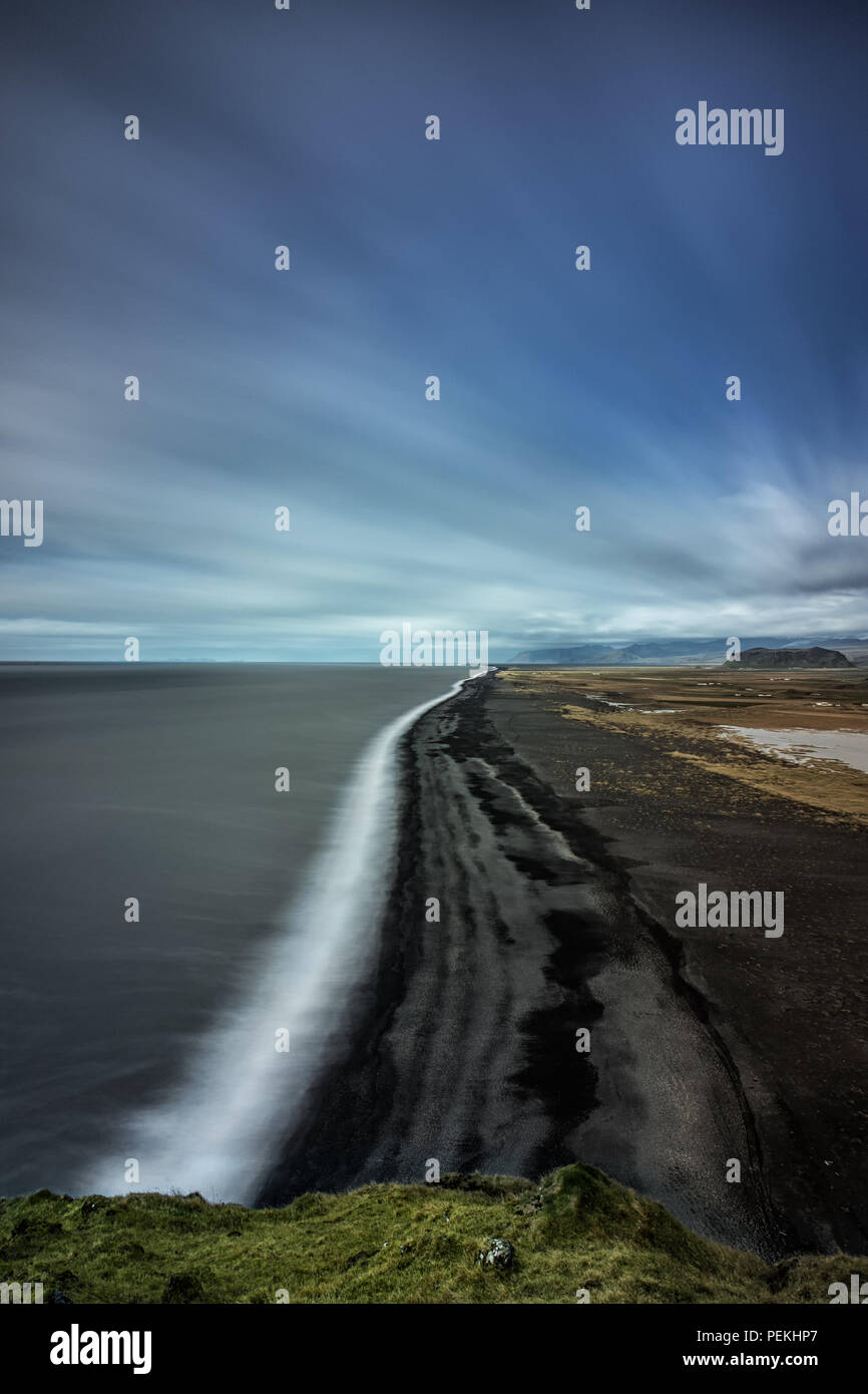 View of the Icelandic coast from Dyrholaey showing the black sand beaches - Stock Image