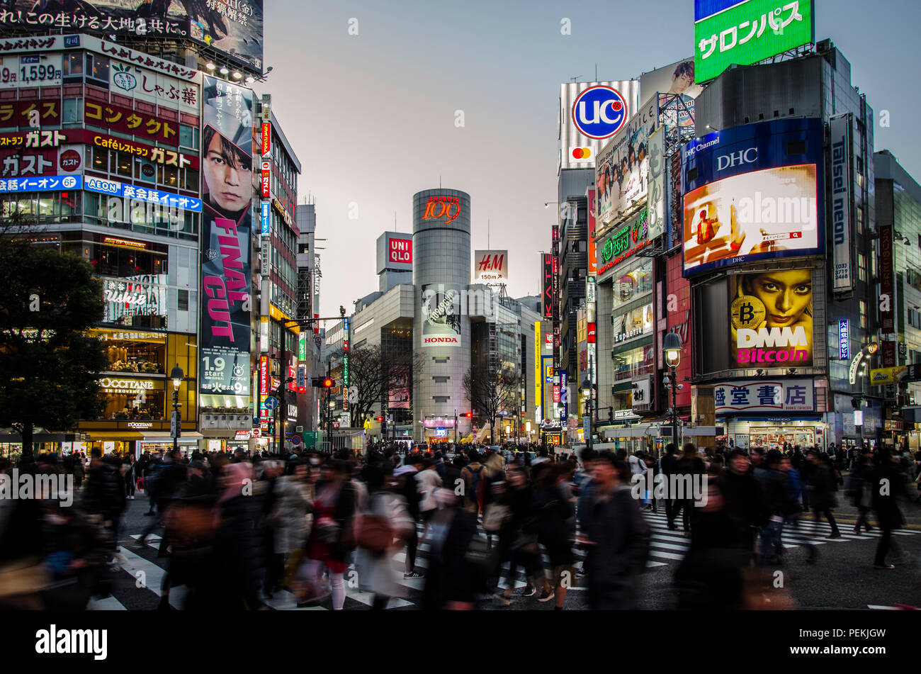 Crowd of people passing Shibya crossing in Tokyo Japan. Vibrant city view, urbanscape, colors of the city. - Stock Image