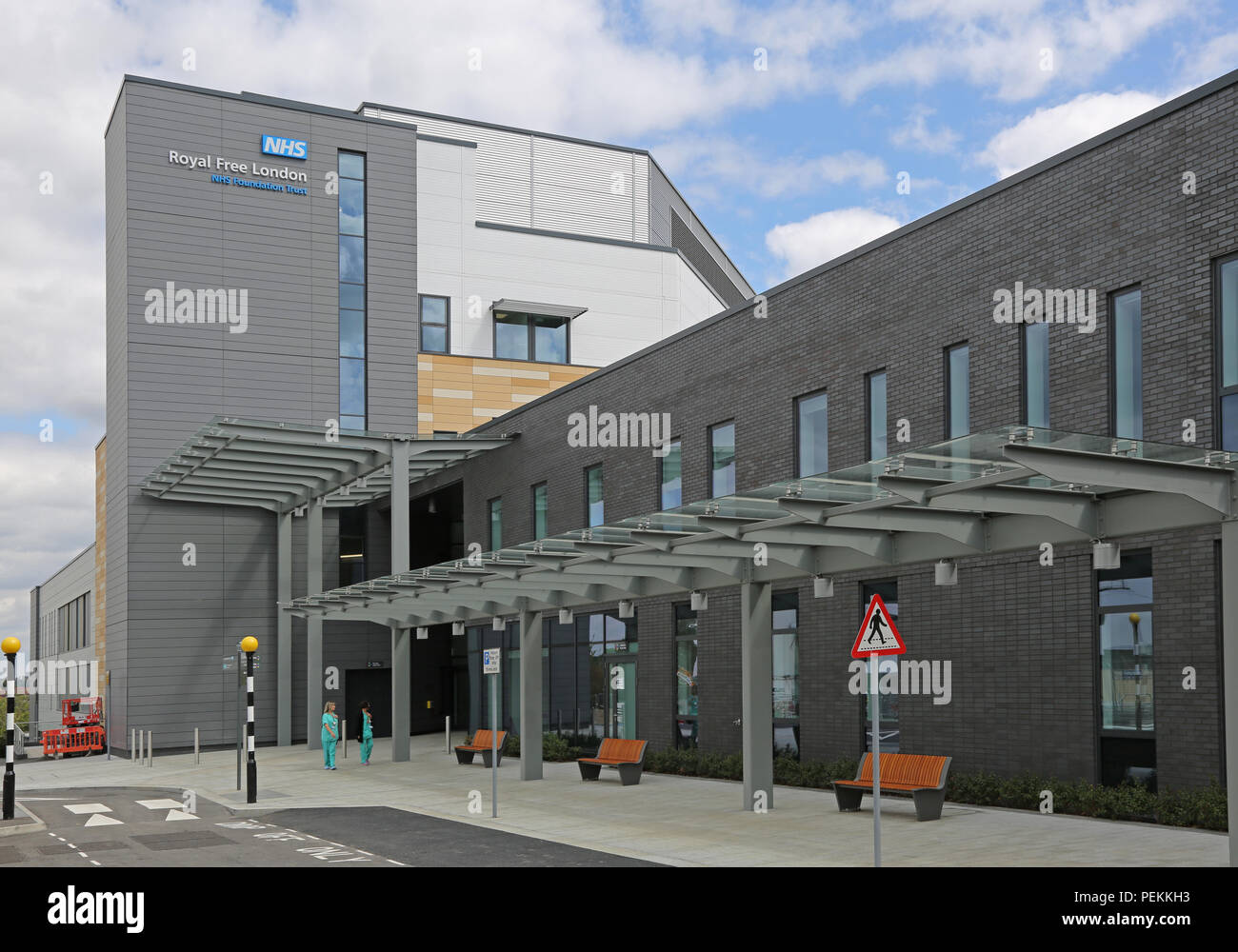 Main entrance to the new NHS Royal Free Hospital on the Chase Farm Hospital site, Enfield, north London. Opening Summer 2018, Shows doctors leaving. Stock Photo
