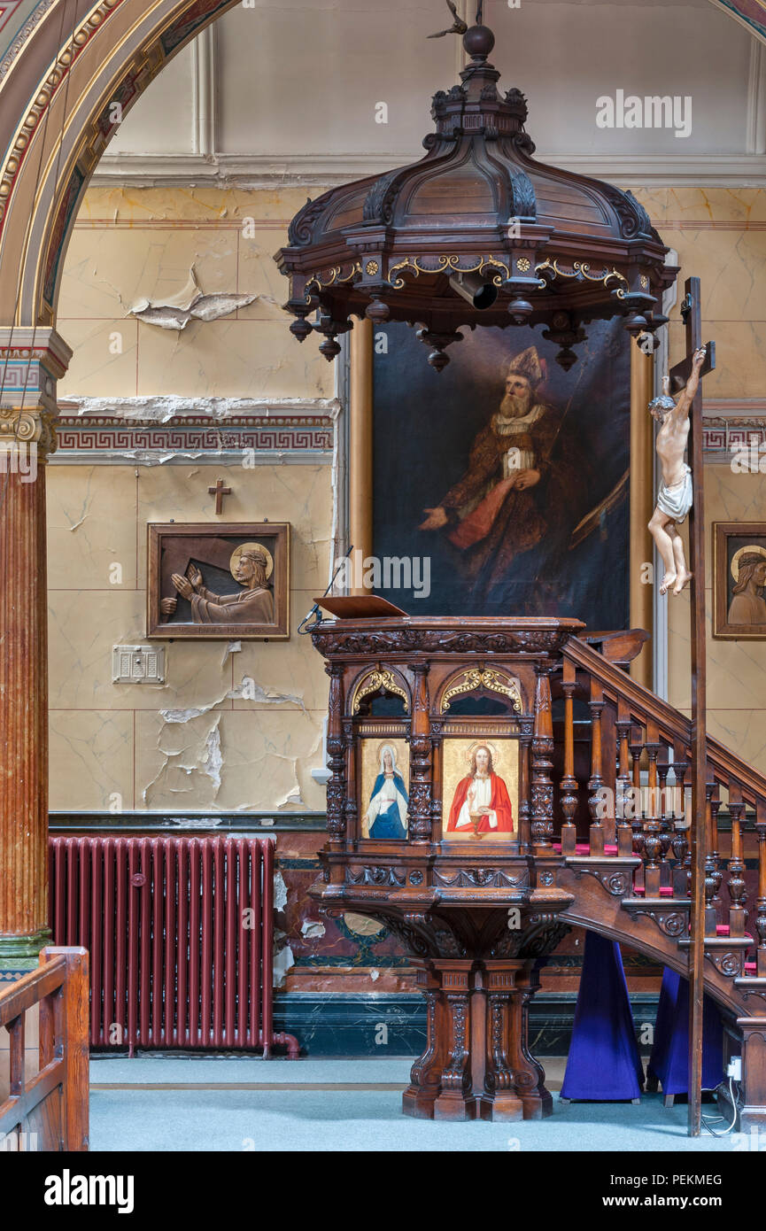 Kingston upon Hull, Yorkshire, UK. The early 19c Catholic church of St Charles Borromeo, Water damage to the walls - Stock Image