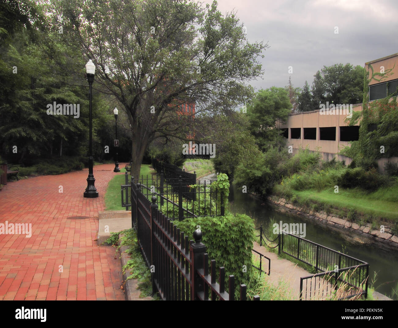 The Onondaga Creekwalk in Syracuse, New York. A public walking path running from Onondaga lake into downtown Syracuse, NY - Stock Image