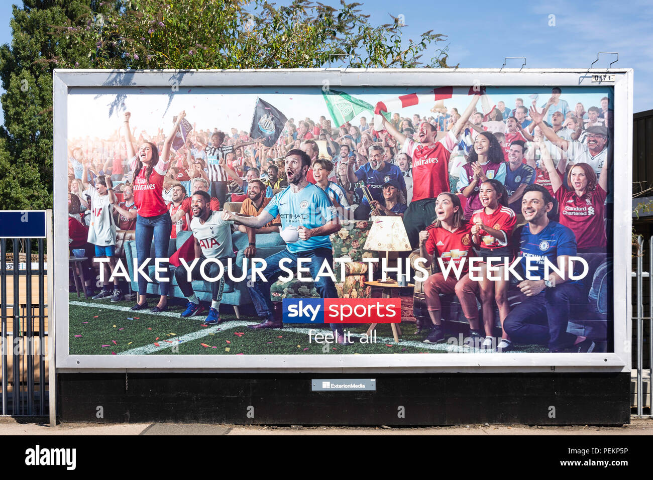 Sky Sports advertising hoarding on train platform, Ashford, Surrey, England, United Kingdom - Stock Image