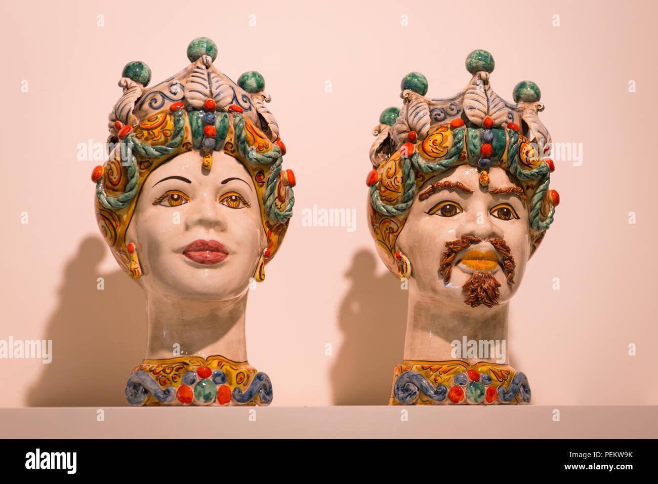 Italy Sicily Syracuse Siracusa Ortygia traditional heads busts Maiolica pottery Sicilian ceramic art Sicilian XI century legend decapitated head - Stock Image