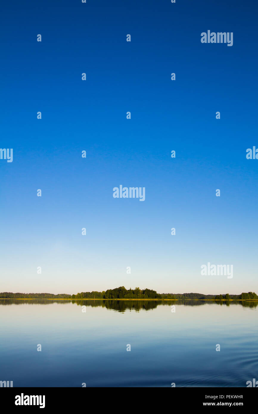 Horizon over the lake in the morning. Latvia, Latgale. - Stock Image