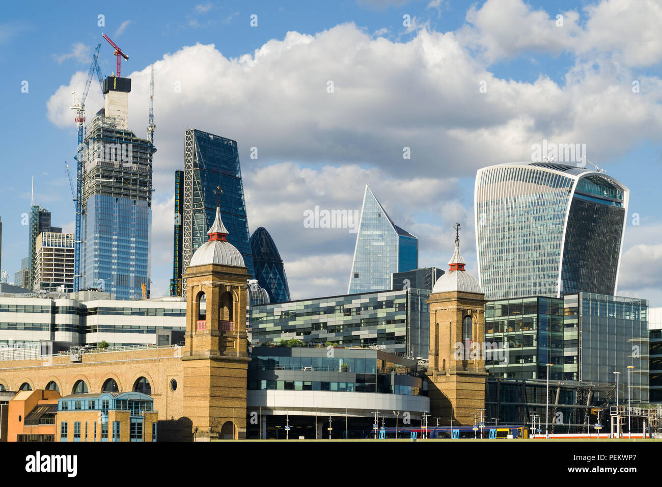 View of the city of London buildings from Southwark Bridge with Cannon street station in foreground on a sunny Summer afternoon, London, UK - Stock Image