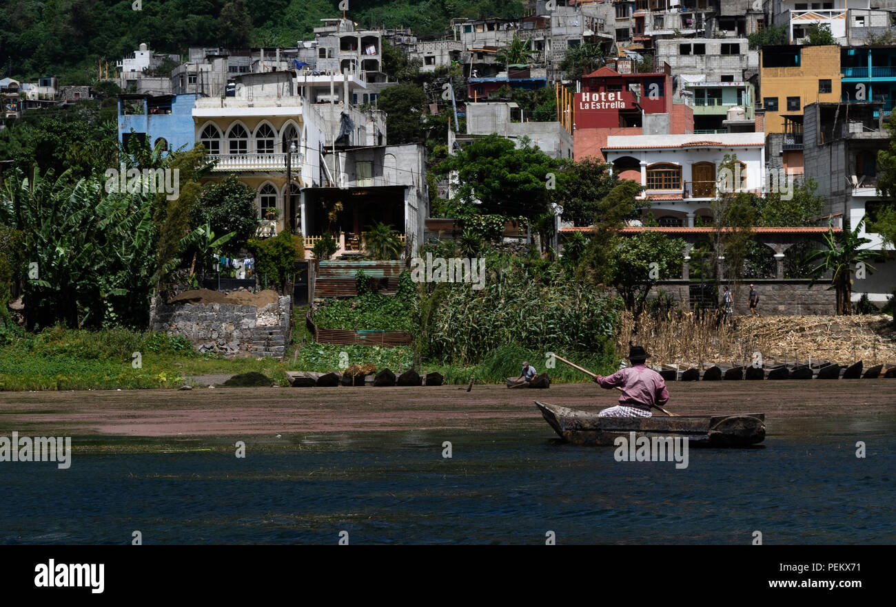 Citizens of near by towns fishing in a canoes in Lake Atitlan, Solola, Guatemala. 14 July 2018 - Stock Image