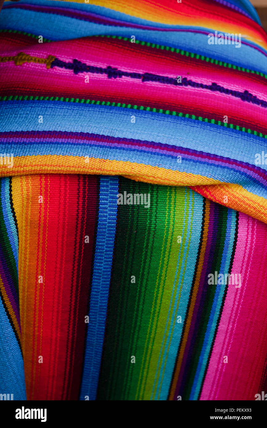 The colors of the rainbow but threded together one by one. - Stock Image