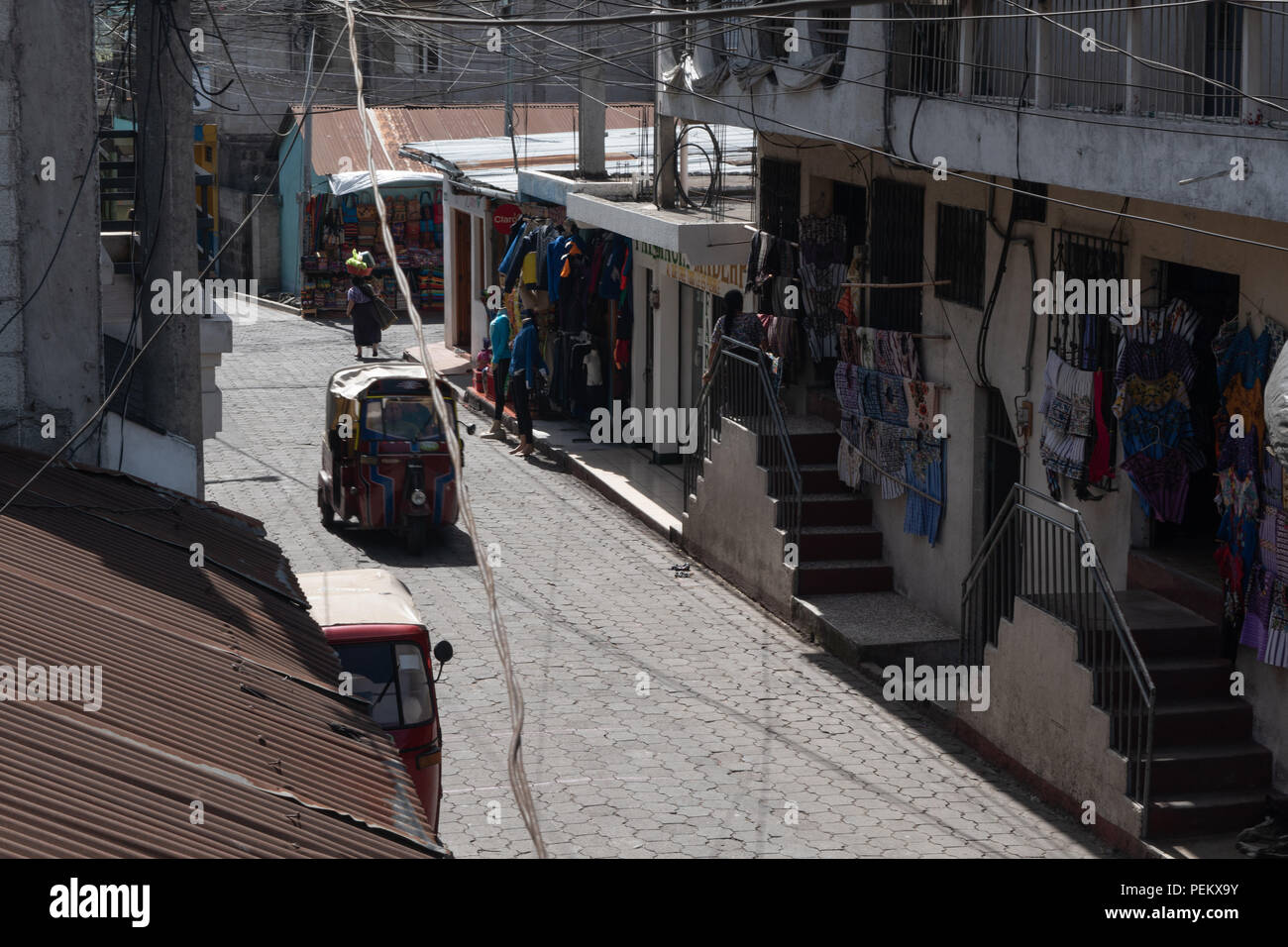 The roads of Santiago Atitlan, the local public transportation and business. 14 July 2018 - Stock Image