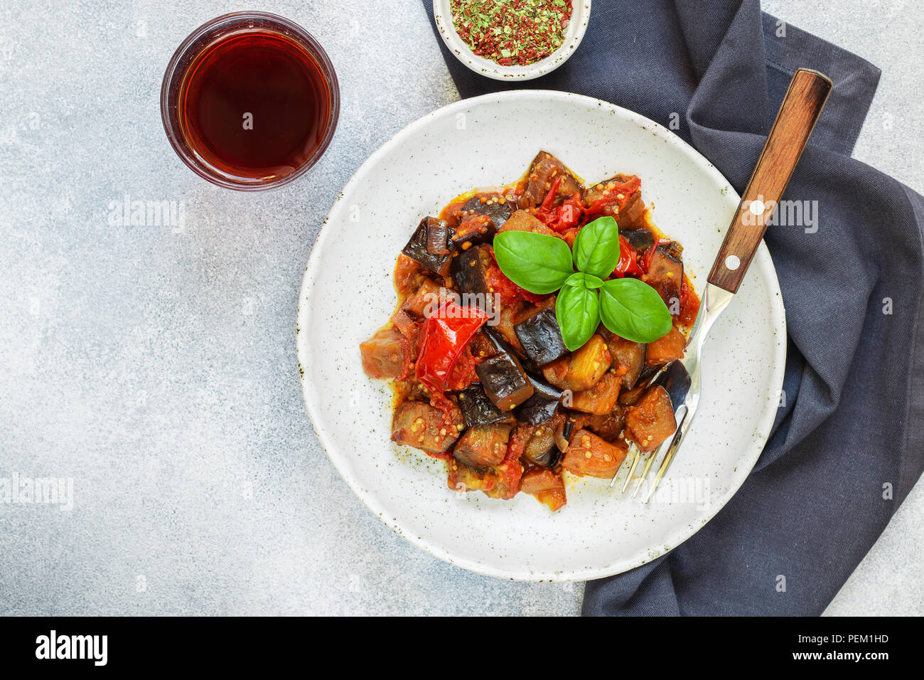 Caponata is a traditional Sicilian dish. Stew of vegetables-eggplant, tomatoes, onions, Basil and olives with seasonings and spices. Selective focus - Stock Image