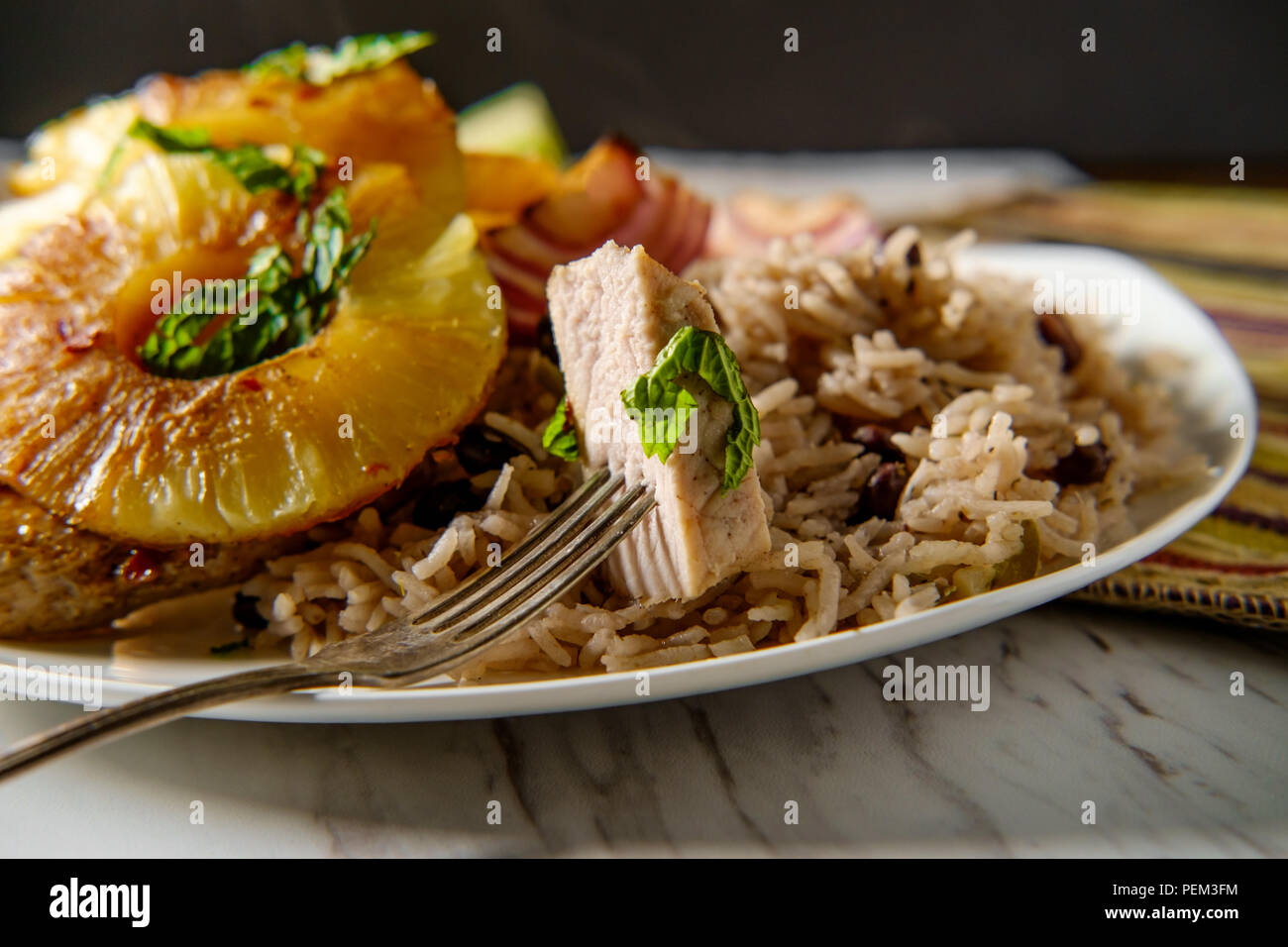 Marinated Cuban pineapple pork chops with traditional black