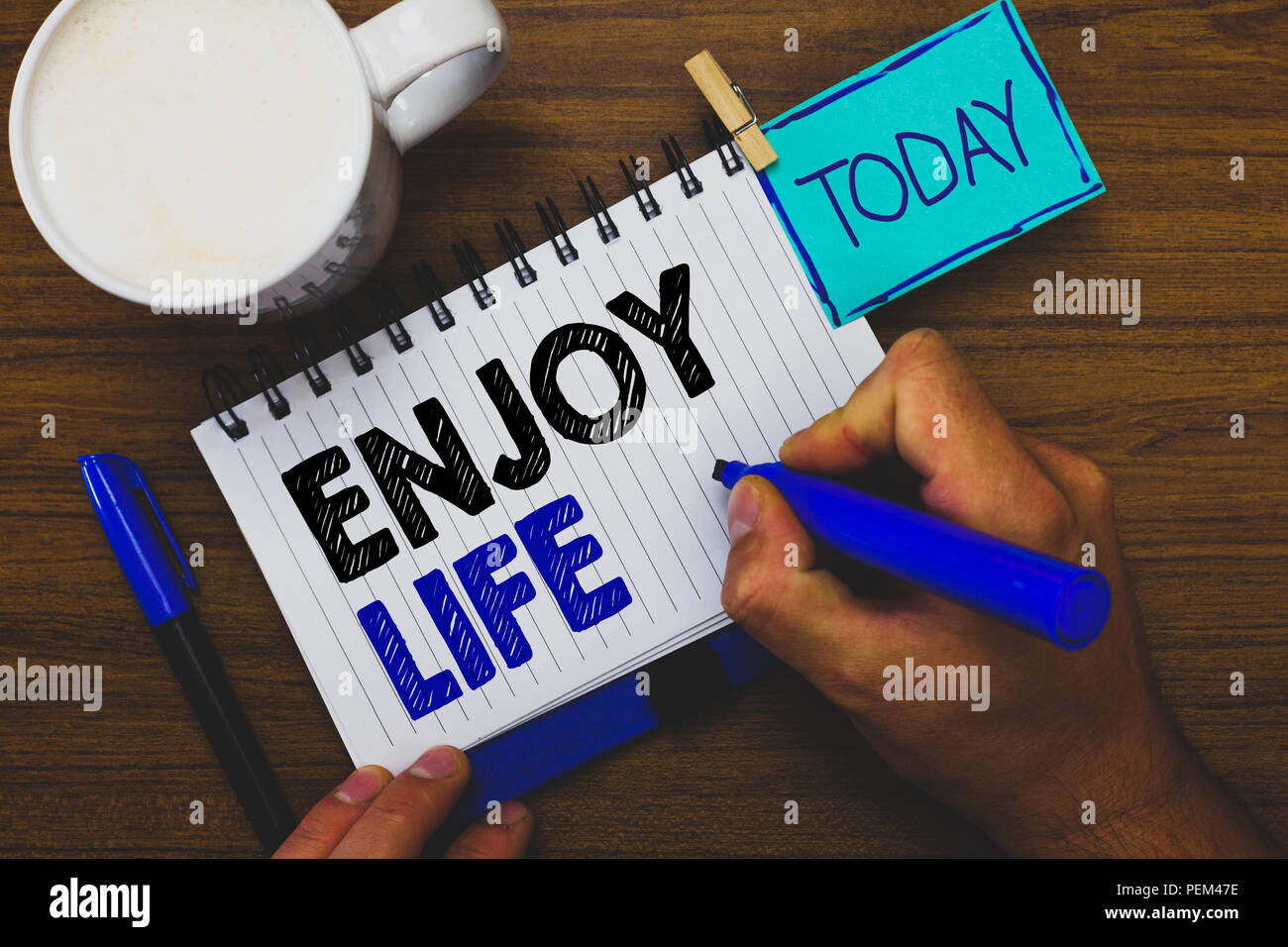 Word writing text Enjoy Life. Business concept for Any thing, place,food or person, that makes you relax and happy Man holding marker notebook clothes - Stock Image