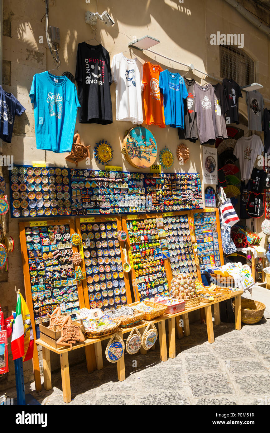 Italy Sicily Syracuse Siracusa Ortygia souvenir shop store tee t shirts typical pottery ceramic trinkets puppets tea towels bags fans tambourin - Stock Image