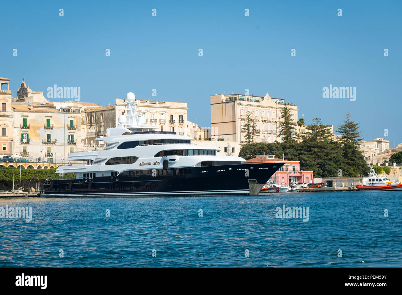 Italy Sicily Syracuse Siracusa Ortygia island stronghold ocean going luxury private yacht cruise ship boat Martha Ann berth mooring Union Jack - Stock Image