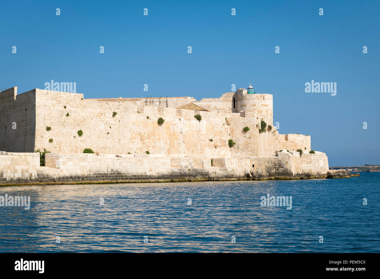 Italy Sicily Syracuse Siracusa Ortygia island stronghold fort fortress bastion castle Castello Maniace built 1200s by Frederick II lighthouse sea - Stock Image