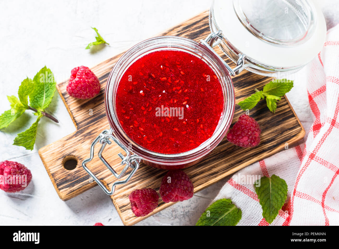 Strawberry jam in glass jar top view.  - Stock Image